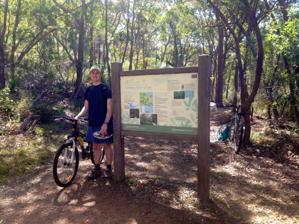 Biking/hiking up Mount Rooper in Airlie.