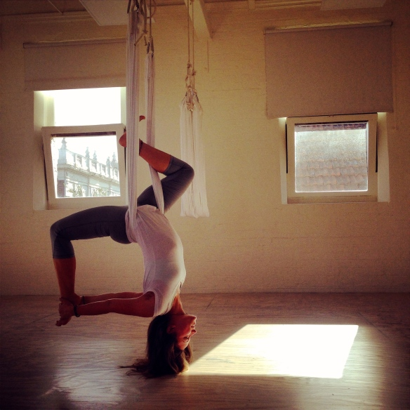 """Alex is doing some """"karma work"""" at Body Flow, an aerial yoga studio, for membership and mentorship."""