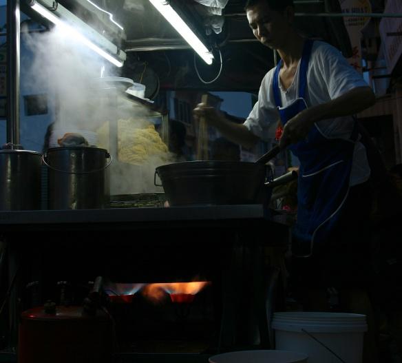 Hawker cooking our Wan Tan Mee on Chulia Street.