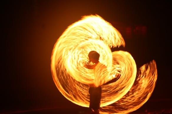 Beachside fire twirlers.