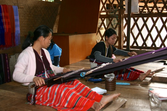 Karin tribeswomen weaving traditional clothing and bedding