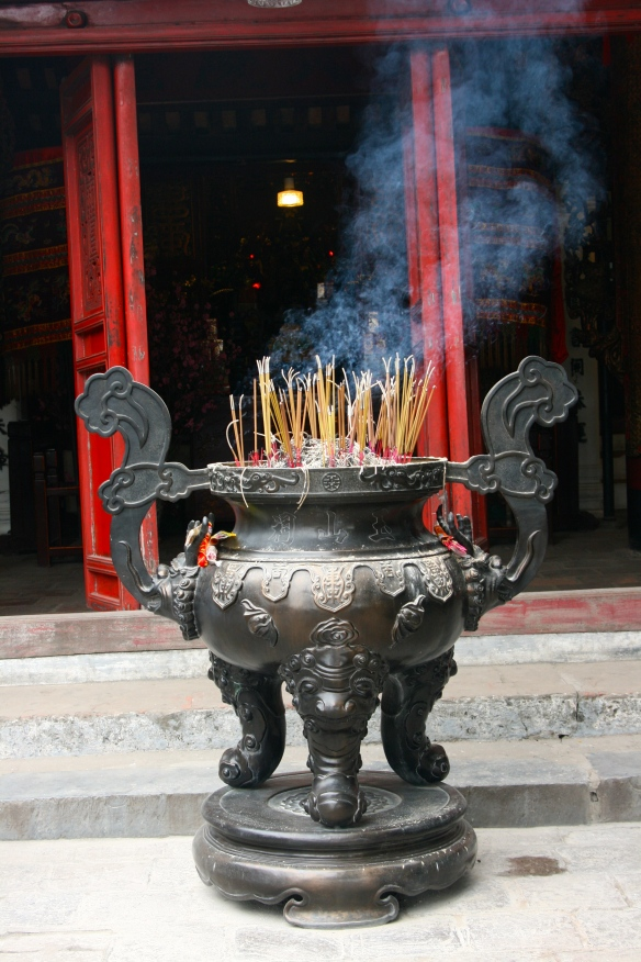 Incense offerings in front of a Chinese Temple