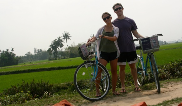 Biking along the bumpy dirt paths that run through the rice fields